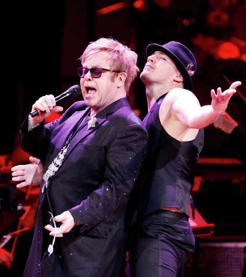Elton John, left, and actor Channing Tatum perform together during the Revlon Concert for the Rai