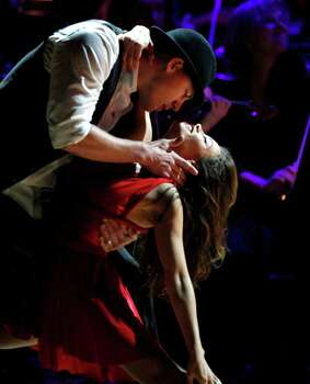 Actor Channing Tatum and his wife Jenna Dewan Tatum perform together during the Revlon Concert for the Rainforest Fund at Carnegie Hall, Tuesday, April 3, 2012 in New York. Photo: Jason DeCrow, AP / FR103966 AP