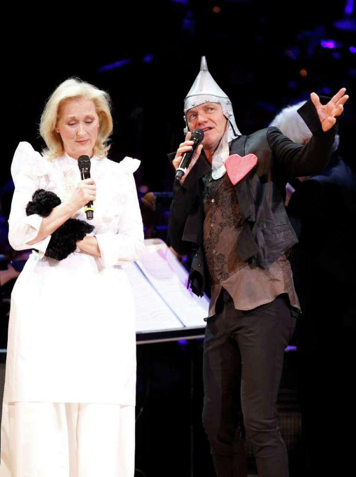 Meryl Streep and Sting perform dressed as characters from The Wizard of Oz during the Revlon Concert for the Rainforest Fund at Carnegie Hall, Tuesday, April 3, 2012 in New York.
