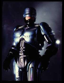 """There's plenty of Houston scenery in 1990's """"Robocop 2."""" Shooting locations include the Budweiser brewery on I-10, Post Oak Blvd., Main Street, the Wortham Center, the intersections of Congress and La Branch, Prairie and Main and Rusk and Fannin, Jefferson Davis Hospital, Lyons Avenue and The Americas on Runnels Street.  Photo: William Hawkes, Orion Pictures Corp. / handout slide"""