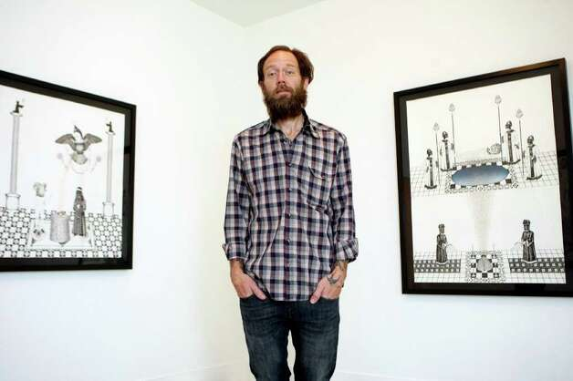 "Artist James Smolleck, who hasn't exhibited since 2006, has mounted an exhibit, ""Neophyte Doublestare Into the Eighth Dimension"" at Sala Diaz.  Photo: Helen L. Montoya, San Antonio Express-News / ©SAN ANTONIO EXPRESS-NEWS"