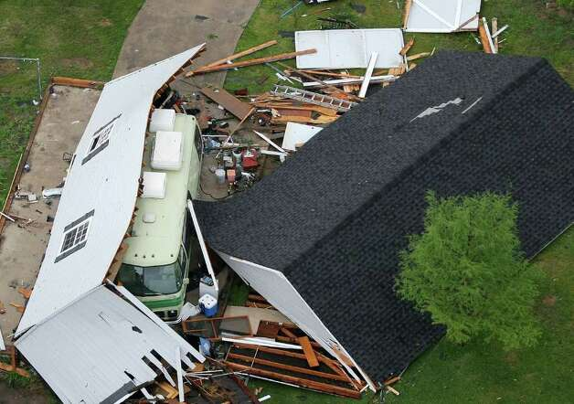 A structure in Arlington, Texas, lies destroyed after a tornado hit the area, on Tuesday, April 3, 2012. (Khampha Bouaphanh/Fort Worth Star-Telegram/MCT) Photo: Khampha Bouaphanh, MBR / Fort Worth Star-Telegram