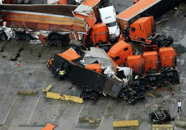 A tornado causes damages at the Schneider National's Trucking Hub in South Dallas, Texas, on Tuesday, April 3, 2012. (Khampha Bouaphanh/Fort Worth Star-Telegram/MCT) Photo: Khampha Bouaphanh, MBR / Fort Worth Star-Telegram