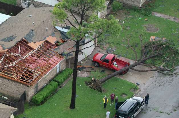 A tornado caused damage to homes in Arlington, Texas, on Tuesday, April 3, 2012. (Khampha Bouaphanh/Fort Worth Star-Telegram/MCT) Photo: Khampha Bouaphanh, MBR / Fort Worth Star-Telegram