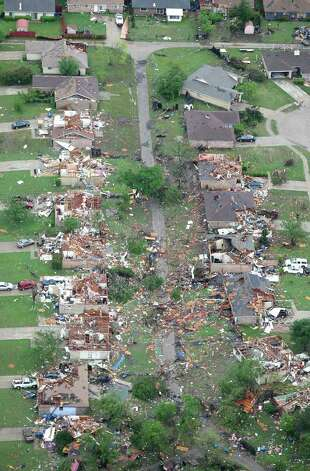 Homes were destroyed in Kennedale, Texas, after a tornado hit the area, Tuesday, April 3, 2012. (Khampha Bouaphanh/Fort Worth Star-Telegram/MCT) Photo: Khampha Bouaphanh, MBR / Fort Worth Star-Telegram