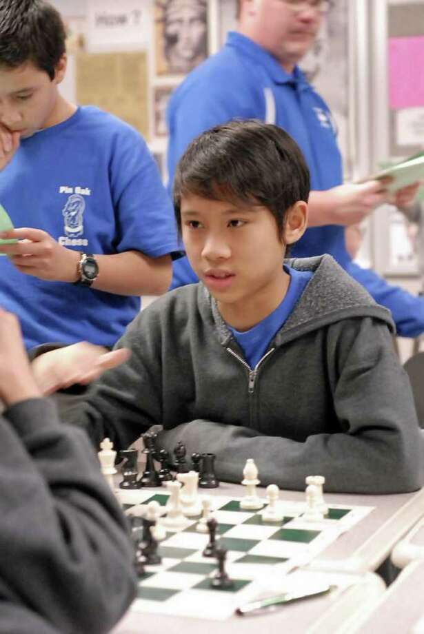Eric Chu (13) - with the Pin Oak Middle School chess team - practices at their school Friday 3/09/12. Photo by Tony Bullard. Photo: Tony Bullard / Tony Bullard & the Houston Chronicle