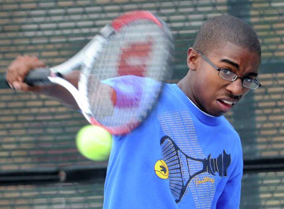 Malik Norris demonstrates his tennis skills at Ozen High School in Beaumont, Thursday. Tammy McKinley/ The Enterprise Photo: TAMMY MCKINLEY / Beaumont