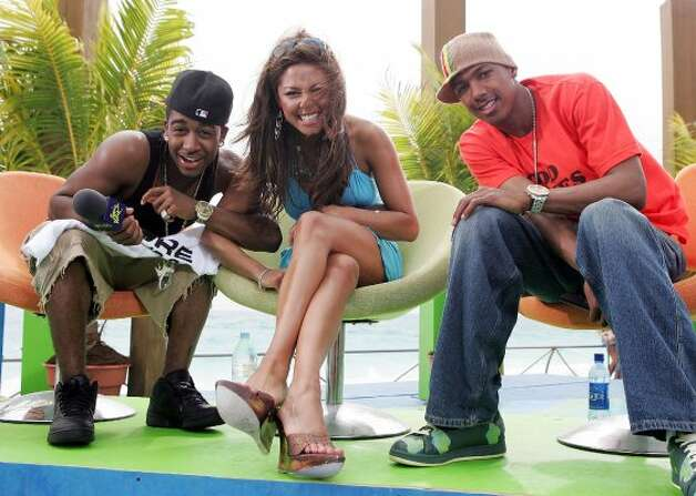 CANCUN, MEXICO - MARCH 9:   (U.S. TABS OUT) Singer Omarion (L), VJ Vanessa Minnillo, and actor Nick Cannon pose for a photo onstage during a taping for MTV Spring Break on the beach at The City nightclub March 9, 2005 in Cancun, Mexico.  (Photo by Scott Gries/Getty Images) (Getty Images)