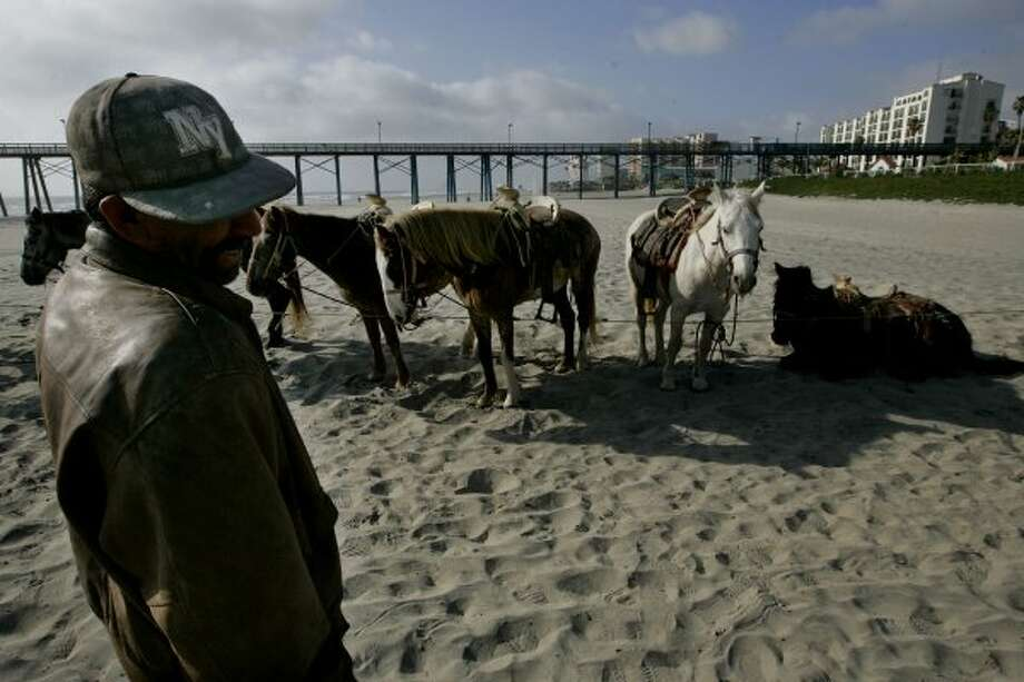 ROSARITO, MEXICO - APRIL 1:  A horse rental vendor waits for customers along the beach April 1, 2009 in Rosarito, Mexico.  The tourist industry in some northern Mexican resort towns is feeling the effects of the ongoing drug war, as students from the U.S. are curtailing their spring break plans and traveling domestically instead.(Photo by Sandy Huffaker/Getty Images) (Sandy Huffaker / Getty Images)