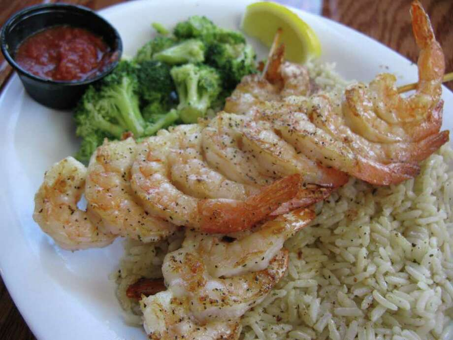 Beef O Brady isn't all beef. It has chicken wings and serves grilled shrimp with rice and broccoli. Photo: Jennifer McInnis, San Antonio Express-News