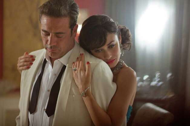 Jeffrey Dean Morgan and Olga Kurylenko play loving spouses Ike and Vera Evans.