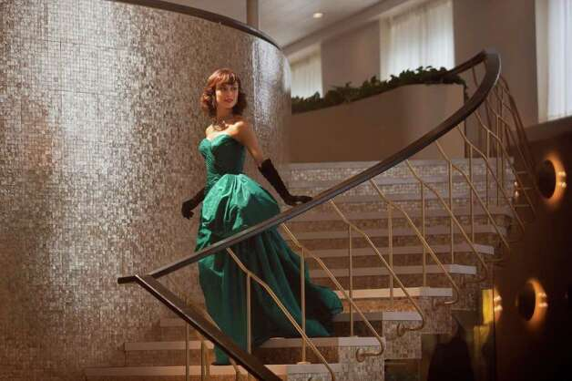 Olga Kurylenko makes an entrance in one of the series' fabulous gowns.