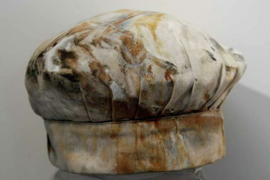 A baker's hat belonging to third baker William E. Hine from the RMS Titanic Inc. on display at Guernsey's Auctioneers & Brokers,  Wednesday, April 4, 2012 in New York.    The auction of more than 5,000 Titanic artifacts a century after the luxury liner's sinking has stirred hundreds of interested calls, with some offering to add to the dazzling trove already plucked from the ocean floor. Photo: Mary Altaffer, AP / AP