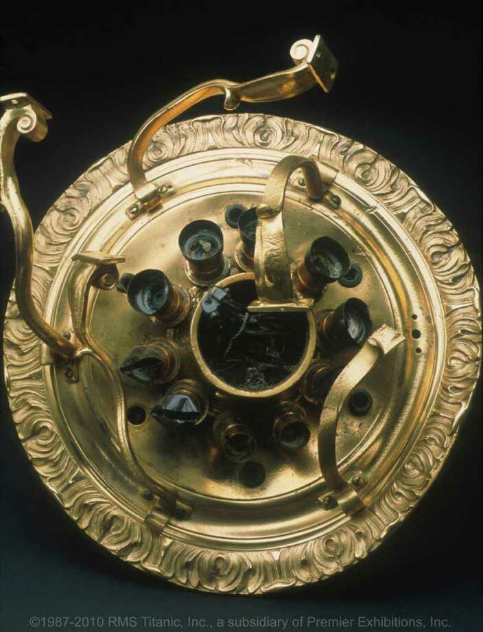 This October 19, 2011 image provided by RMS Titanic, Inc. shows a porthole from the RMS Titanic which was recovered from the ocean floor during an expedition to the site of the  tragedy.  The piece along with 5,000 other artifacts will be auctioned as a single collection on April 11, 2012, 100 years after the sinking of the ship. Photo: AP / RMS  Titanic, Inc.