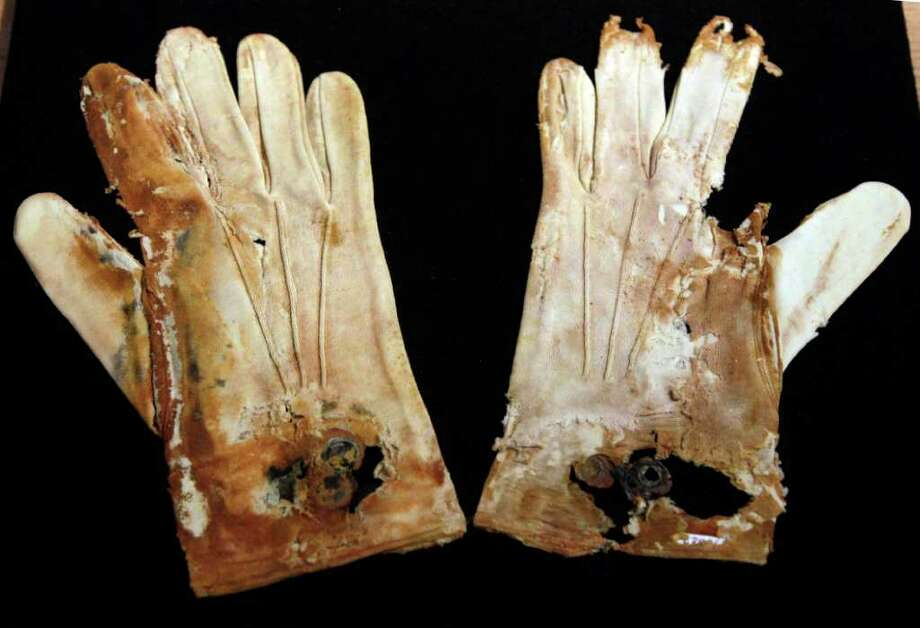 A pair of men's cotton gloves from the RMS Titanic Inc. are on display at Guernsey's Auctioneers & Brokers,  Wednesday, April 4, 2012 in New York.   The auction of more than 5,000 Titanic artifacts a century after the luxury liner's sinking has stirred hundreds of interested calls, with some offering to add to the dazzling trove already plucked from the ocean floor. Photo: Mary Altaffer, AP / AP