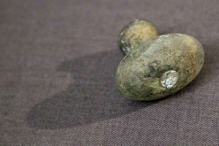 A first class door knob from the RMS Titanic Inc. is on display at Guernsey's Auctioneers & Brokers, Wednesday, April 4, 2012 in New York.    The auction of more than 5,000 Titanic artifacts a century after the luxury liner's sinking has stirred hundreds of interested calls, with some offering to add to the dazzling trove already plucked from the ocean floor. Photo: Mary Altaffer, AP / AP