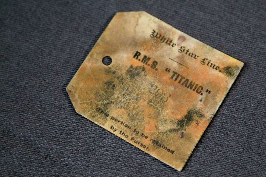 A purser's tag from the RMS Titanic Inc. is on display at Guernsey's Auctioneers & Brokers,  Wednesday, April 4, 2012 in New York.    The auction of more than 5,000 Titanic artifacts a century after the luxury liner's sinking has stirred hundreds of interested calls, with some offering to add to the dazzling trove already plucked from the ocean floor. Photo: Mary Altaffer, AP / AP