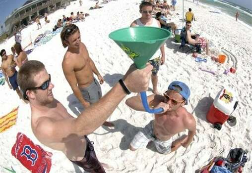 Students on spring break from the University of Tennessee funnel beers near the Whale's Tail Restaurant on Miramar Beach, Florida on Thursday, March 22, 2012. Photo: Nick Tomecek, AP, Northwest Florida Daily