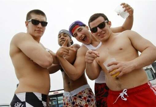 Spring breakers pose for the camera Monday, March 12, 2012 on Padre Island in Corpus Christi, Texas. Photo: Michael Zamora, AP, Corpus Christi Caller-Times