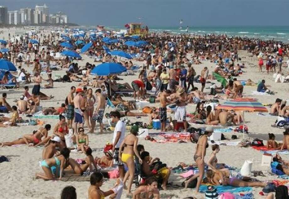 College students flocking to South Florida enjoy Miami Beach, on Friday, March 9, 2012, in Miami for Spring Break. Neither high gas prices, rising airfares nor a relatively mild winter in the Northeast and Midwest seems to be proving a deterrent to drawing revelers, industry experts say. Photo: AP Photo, Al Diaz, Miami Herald