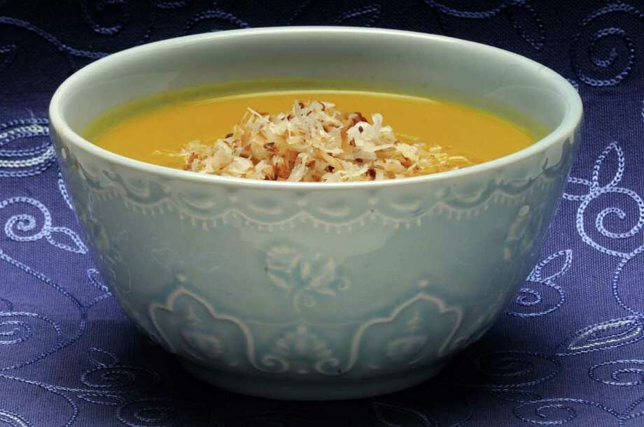 A bowl of carrot soup with toasted coconut on top in Colonie N.Y., Thursday March 29, 2012. (Michael P. Farrell/Times Union) Photo: Michael P. Farrell