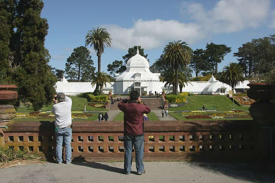 Tourists take photos of the Conservatory of Flowers under clear blue skies on Wed. Apr. 4th, 2012. Photo: Douglas Zimmerman, SF Gate