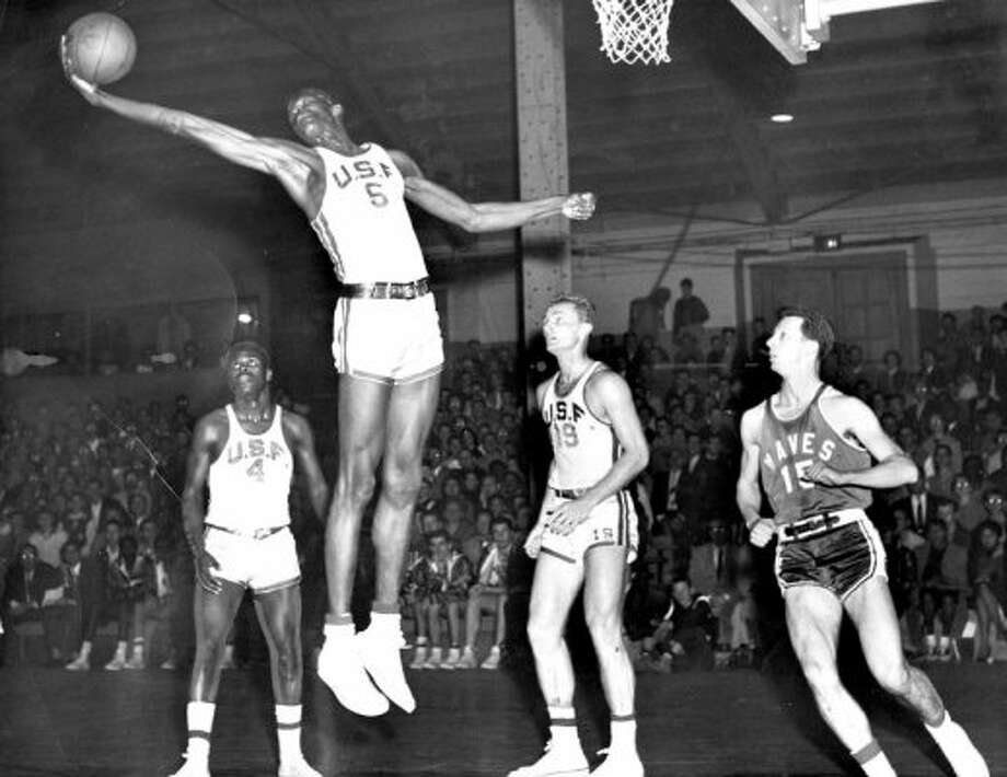 Another not technically Bay Area-born star that was had to include: Bill Russell was truly one of the greats. Although born in Louisiana, Russell relocated to Oakland when he was eight and won two national championships at USF. Here, Russell stretches for a rebound while playing against the Pepperdine Waves in 1956. That's K.C. Jones on the left, who won eight NBA titles with Russell.