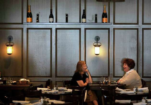 Lorna Tunick, left, and Terry Finneran enjoy a chat over lunch at Bissell House in Ridgefield on Wednesday, April 4, 2012. Photo: Jason Rearick / The News-Times