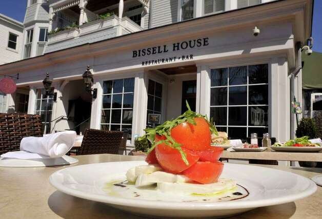 The hand-tossed, house-made mozzarella and tomato salad is a featured item on Bissell House's menu. Bissell House offers outdoor seating along Main Street in Ridgefield. The restaurant describes its menu as new Americain bistro style. Photographed on Wednesday, April 4, 2012. Photo: Jason Rearick / The News-Times