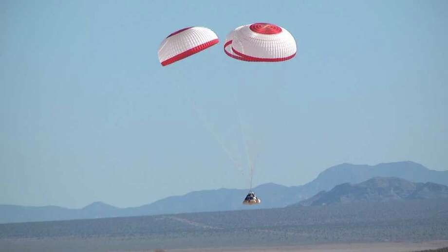 Boeing carries out a parachute drop test of its Crew Space Transportation (CST)-100 spacecraft on April 3, 2012 at the Delamar Dry Lake Bed near Alamo, Nev. Photo: Boeing