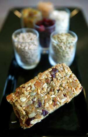 Stephen Paprocki's Deluxe Overnight No-Bake Power Bars are seen Wednesday April 4, 2012 at the Security Service Federal Credit Union's corporate headquarters cafeteria.  (William Luther/wluther@express-news.net) Photo: William Luther, San Antonio Express-News / © 2012 WILLIAM LUTHER
