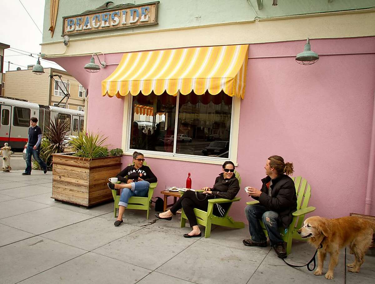 People enjoy coffee outside of the Beachside Coffee Bar in San Francisco, Calif. on March 29th, 2012.