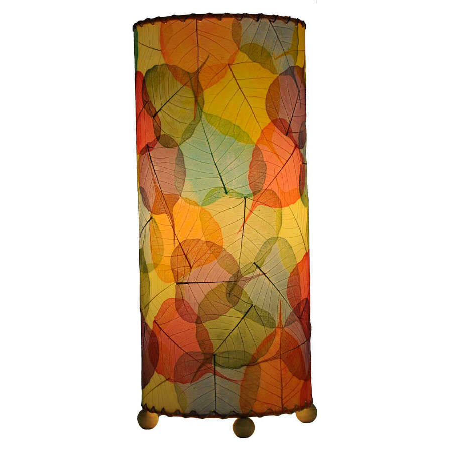 Made with the leaves of the banyan tree, this table lamp by Evangee Home Design will brighten a room with shades of citrus. It?s $140 at Bliss on 19th, 235 W. 19th St., 832-673-0099, blisson19th.com. Photo: Evangee Home Design
