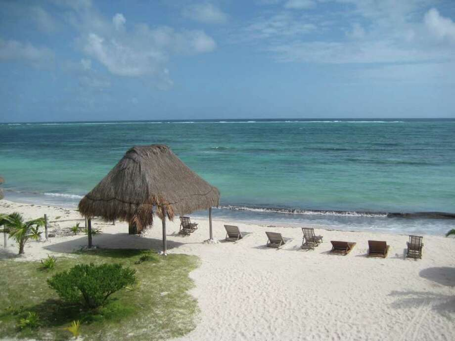 This December 2011 photo shows the beach at the Mayan Garden Inn near Majahual in Costa Maya, Mexico. This region of Mexico is located on the coast of the Western Caribbean, south of Cancun and the Riviera Maya. (AP Photo/Kim Curtis) Photo: Kim Curtis / AP