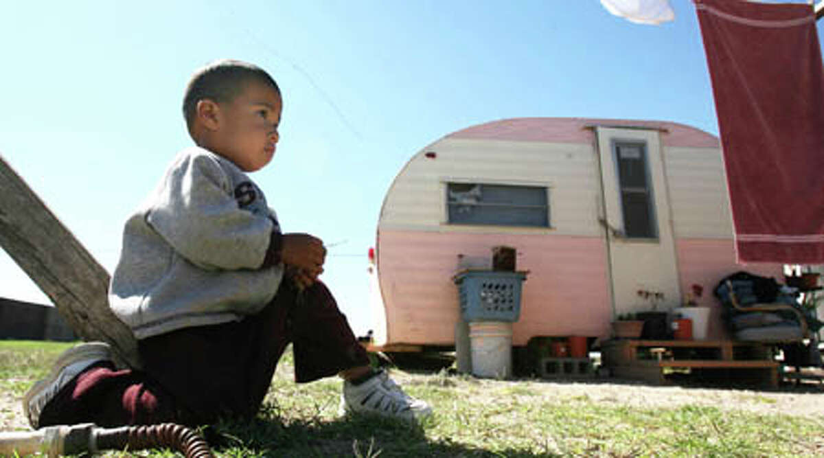 Poorest cities:McAllen, Texas:A 2-year-old boy sits outside his great-grandmother's trailer in the colonia La Joya outside McAllen in 2007.