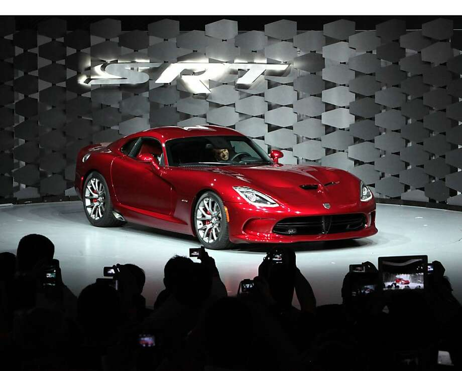 Chrysler's Ralph Gilles, here showing off the 2013 SRT Viper GTS, tangled with Donald Trump in tweets refuting claims about offshoring Jeep jobs. Photo: Associated Press