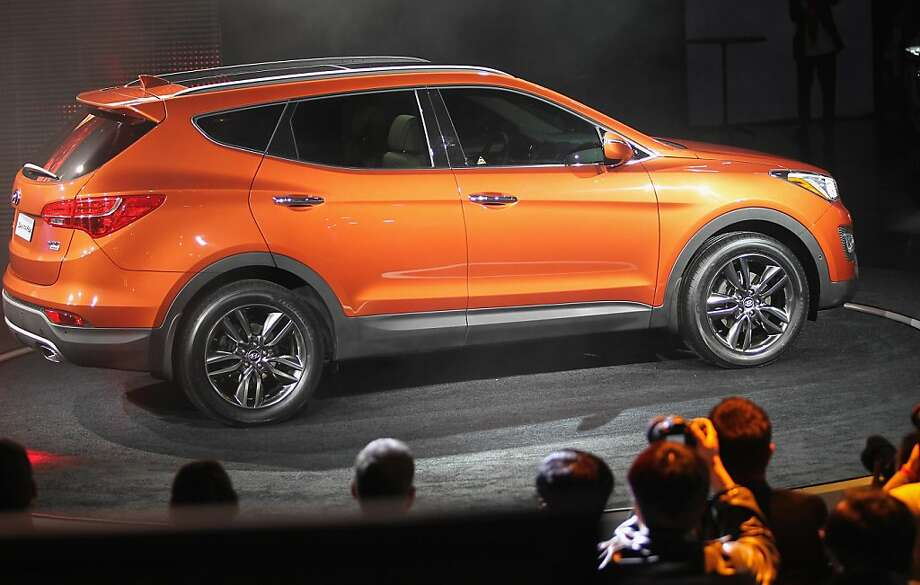 NEW YORK, NY - APRIL 04:  The new 2013 Hyundai Santa Fe is displayed at the New York International Auto Show at the Jacob Javits Convention Center on April 4, 2012 in New York City. The New York International Auto Show features nearly 1,000 brand new vehicles from all auto industry sectors and is open to the public April 6-15.     (Photo by Mario Tama/Getty Images) Photo: Mario Tama, Getty Images