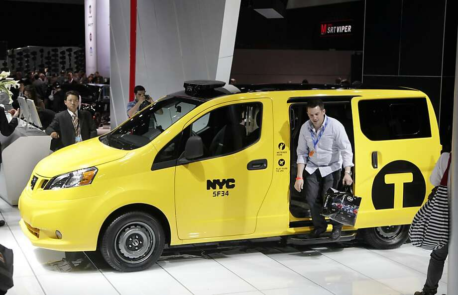 A man steps out of a Nissan 2013 NV200 taxi specifically designed for use in New York City, Wednesday, April 4, 2012 at the New York International Auto Show. (AP Photo/Mark Lennihan) Photo: Mark Lennihan, Associated Press