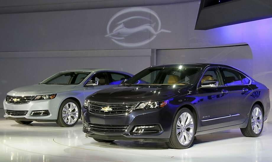 Two 2013 Chevrolet Impalas are unveiled at the New York International Auto Show, in New York's Javits Center,  Wednesday, April 4, 2012. General Motors Co.'s Chevrolet brand is trying to resuscitate sales of big sedans with a sleek, new version of the Impala. (AP Photo/Richard Drew) Photo: Richard Drew, Associated Press