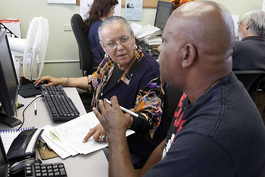 Volunteer Cheryl Fabeo(left) talks to her client Eddie Percoats  as she prepares his tax return at Rubicon's social services agency office in Richmond, Ca on April 2, 2012 Photo: Siana Hristova, The Chronicle