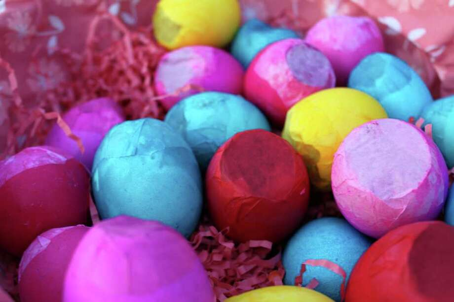 "In this March 2012 image released by Cynthia Leonor Garza, a batch of cascarones are shown at the home of Cynthia Leonor Garza in Washington, D.C. Cascarones are hollowed-out eggs that are dyed, decorated and filled with confetti, then covered with a colorful piece of tissue paper. At Easter time, families make or buy cascarones, which is Spanish for ""eggshells,"" for crushing over each other's heads. The tradition came to the United States from Mexico, where cascarones were used during fiestas and other celebrations. In the United States, it has become primarily an Easter and Fiesta tradition. Photo: AP"