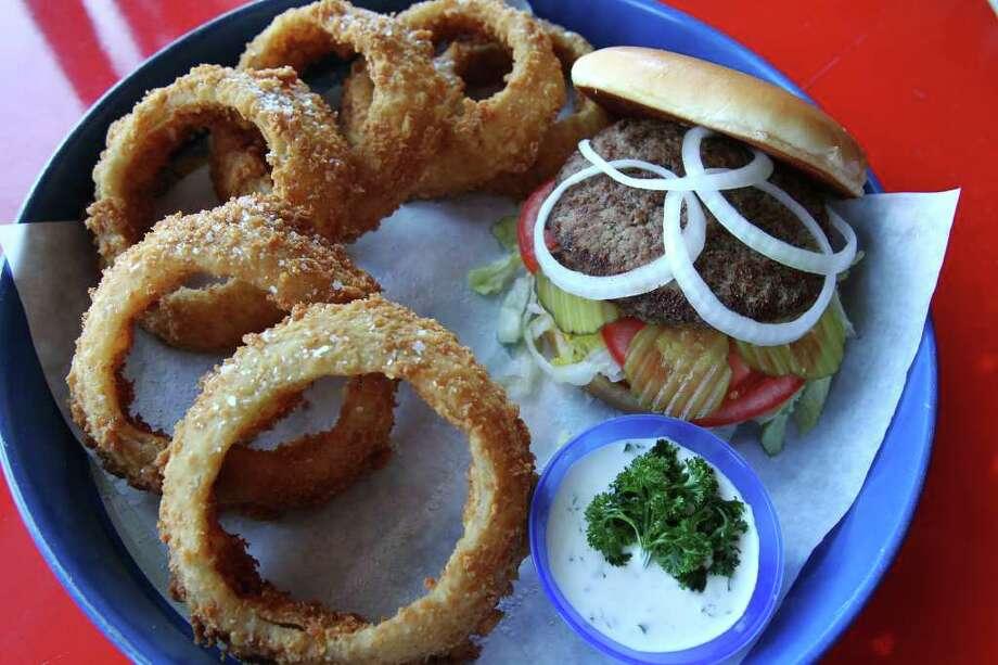 Spanky's Burger Joint burger and onion rings. Photo: TOM REEL, San Antonio Express-News / San Antonio Express-News