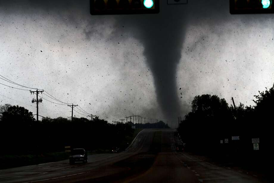 Honey, could you drive a little faster?A tornado touches down near a highway south of Dallas in Lancaster, Texas. A series of twisters peeled roofs off homes, tossed big-rig trucks into the air and left flattened tractor-trailers strewn along highways and parking lots. Photo: Parrish Velasco, Associated Press