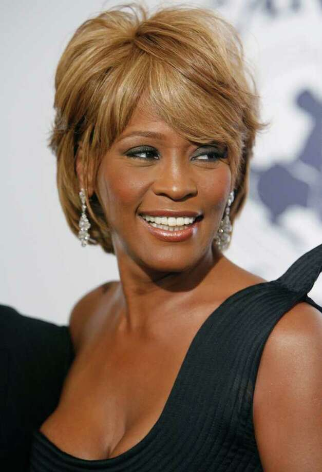 FILE - In this Oct. 28, 2006, file photo, musician Whitney Houston arrives at the 17th Carousel of Hope Ball benefiting the Barbara Davis Center for Childhood Diabetes in Beverly Hills, Calif. An autopsy report shows that cocaine was found in Houston's system and that investigators recovered whity powdery substances from her hotel room.  Houston died Feb. 11, in California at the age of 48. (AP Photo/Matt Sayles, file) Photo: MATT SAYLES / AP2006