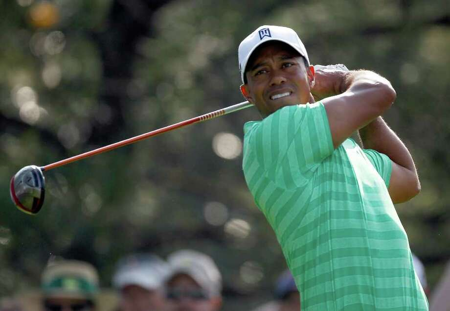 AUGUSTA, GA - APRIL 04:  Tiger Woods tees off during a practice round prior to the start of the 2012 Masters Tournament at Augusta National Golf Club on April 4, 2012 in Augusta, Georgia. Photo: Streeter Lecka, Getty Images / 2012 Getty Images