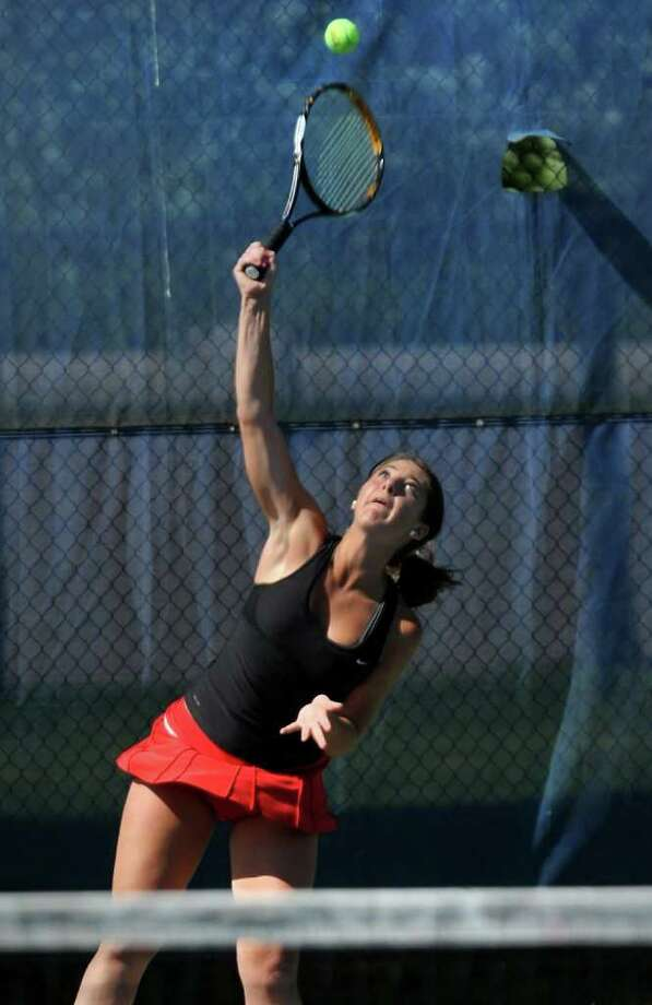 New Canaan's Courtney Gallagher serves the ball during last year's state tournament clincher against Glastonbury. Photo: Christian Abraham, ST