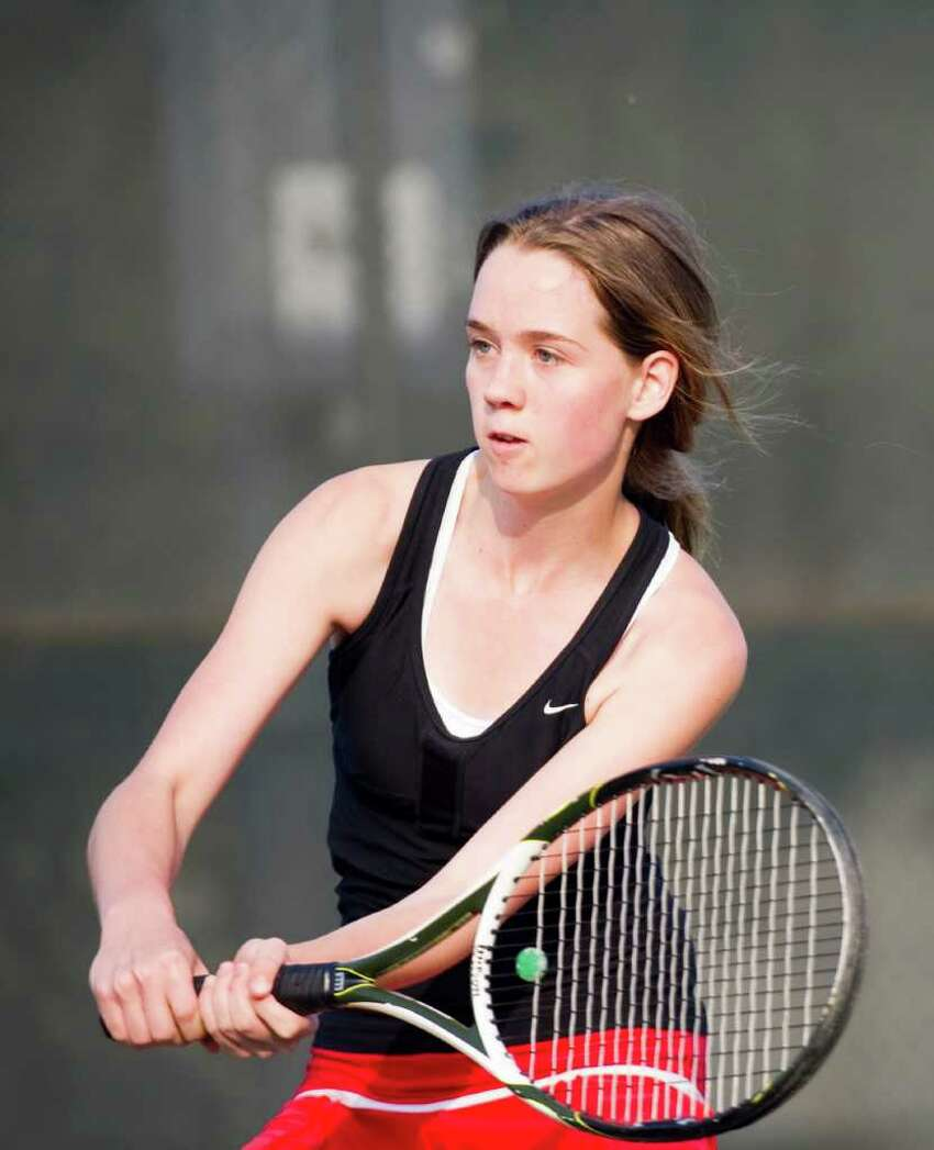 New Canaan's KAte Howard in action as New Canaan and Greenwich High Schools face off in the girls tennis FCIAC finals in Wilton, Conn., May 25, 2011. New Canaan won the title.