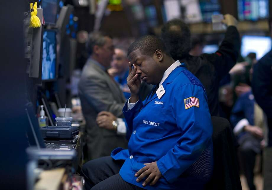 A trader pauses to rub his eyes while working on the floor of the New York Stock Exchange (NYSE) in New York, U.S., on Wednesday, April 4, 2012. U.S. stocks fell, sending the Standard & Poor's 500 Index lower for a second day, as demand dropped at a Spanish bond auction and the Federal Reserve signaled it may refrain from more monetary stimulus. Photographer: Jin Lee/Bloomberg Photo: Jin Lee, Bloomberg