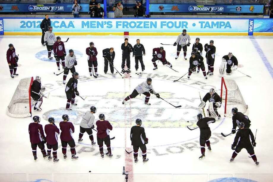 Union College teammates compete during a practice drill for the Frozen Four college hockey championship at the Tampa Bay Times Forum on Wednesday afternoon. [WILLIE J. ALLEN JR., Times] Photo: WILLIE J. ALLEN JR. / Tampa Bay Times