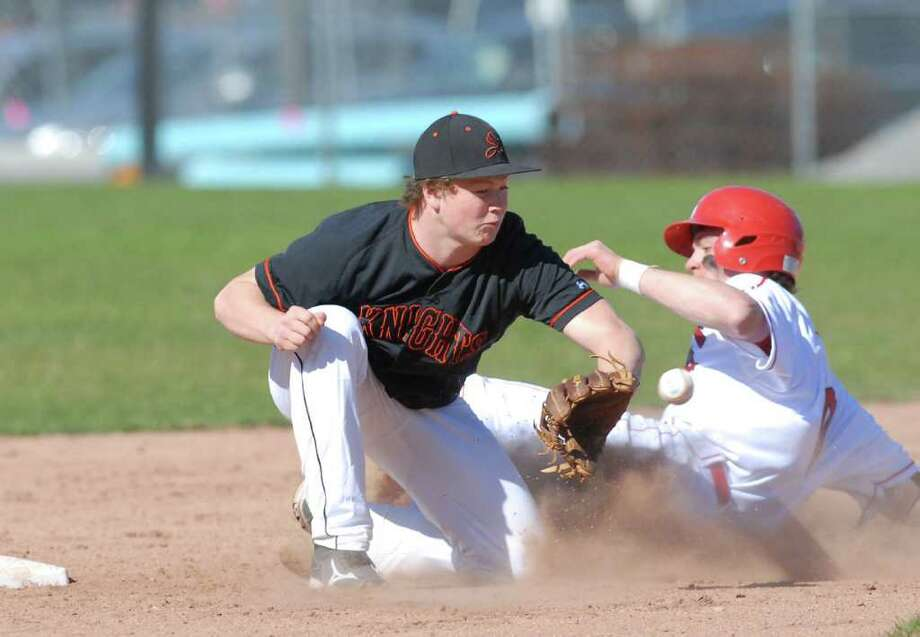Stamford High School second baseman Chandler Foster, left, trys to tag out Taylor Olmstead of Greenwich High School on a steal attempt in the bottom of the second inning in high school baseball game between Stamford High School and Greenwich High School at Greenwich, Wednesday, April 4, 2012. Olmstead was safe on the play and Greenwich went on defeat Stamford 2-0. Photo: Bob Luckey / Greenwich Time